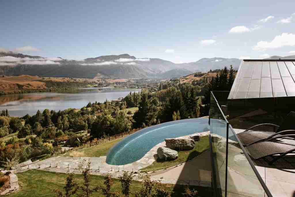 Stoneridge Estate outlook pool in foreground and lake and mountains behind