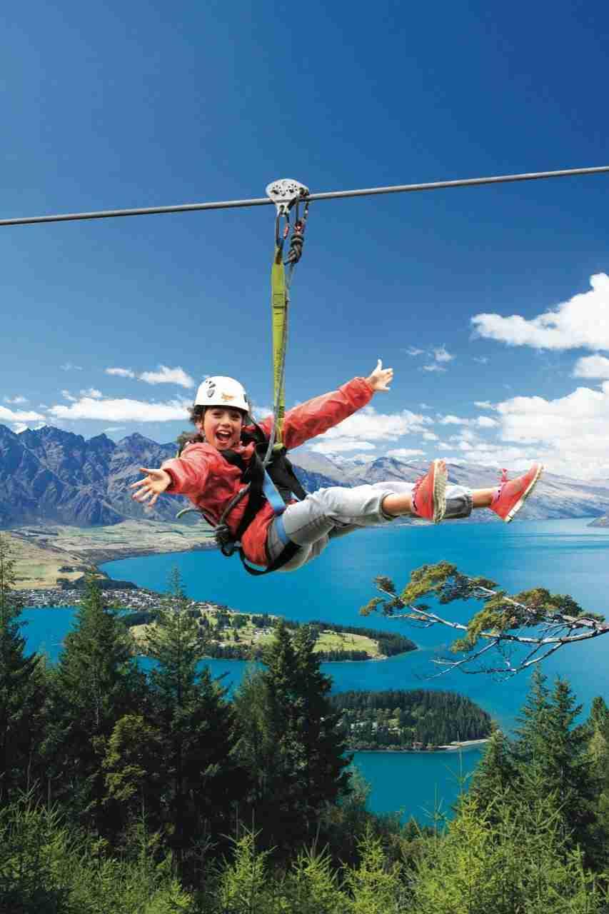 Teenager Ziplining in Queenstown